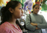 14 year-old  Erica Ruano (cq) shops with her mother Eraclidez Moreno (cq) , 31 in Aurora Wednesday...