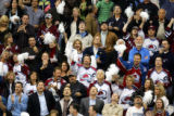 Colorado Avalanche fans cheer as they watch the replay of Joe Sakic's first period power play goal...