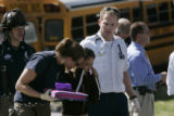 In Denver, Colo. 4/25/06 at 5th and Albion in a freak school bus accident sent some 15 students...