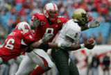 STATE17.SP.123105.EDH   NC State's Renaldo Moses and Mario Williams combine to sack South...