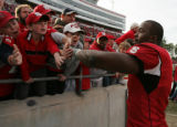 STATE19.SP.112605.EDH -- NC State's Mario Williams is congratulated by fans after NC State's 20-14...