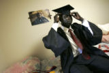 "Kur Anyieth Kur (cq), a ""Lost Boy"" refugee from Southern Sudan, prepares his graduation..."