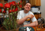 (Vernal, Utah) Jonathan Swain, 21, laughs while eating cake on the evening of his 21st birthday at...