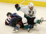 Alex Tanguay and Sean O'Donnell collide in the second period of the Colorado Avalanche against the...