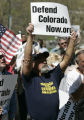 Ottis Boyd, (cq) from Aurora, CO holds a sign during a rally for Defend Colorado Now (DCN)...