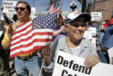 Anita Hernandez(cq) , from Denver  CO holds a sign during a rally for Defend Colorado Now (DCN)...