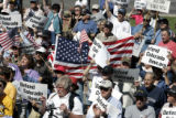 Supporters cheer during a rally for Defend Colorado Now (DCN) Thursday morning , April 27, 2006,...
