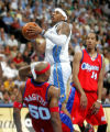 Denver Nuggets forward Carmelo Anthony draws the foul on Los Angeles Clippers defender Corey...
