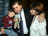 CODZ106 - Colorado Avalanche president Pierre Lacroix, center, is hugged by his 2-year-old...
