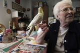 Sister Maggie and Juniper, pet bird of Sister Theresa, in her home. Sister Theresa Langfield,...