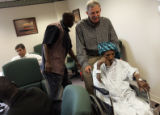 Halimatu Diallo (cq), a resident of Senegal (a country in west Africa), is wheeled back to her...