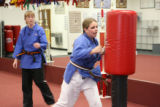 A 14-year-old Brittney Richardson, cq, shows off what she has learned taking karate as her...