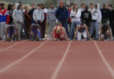 JT Scheuerman(cq), second from right looking up, of Littleton High School, prepares to run during...