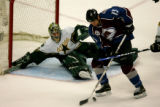 Colorado Avalanche's Dan Hinote, #13, tries to settle the puck to place it on goal as Dallas...