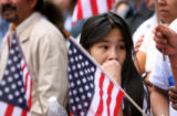 Suri Camorlinga (cq), 12, of Fort Collins stands among the American flags held by her and members...
