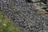 Thousands of runners and walkers head south on Cherry Creek Drive North Sunday morning April 30th...