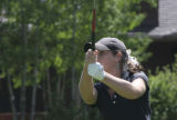 Brooke Collins, Monarch High School player, tees off early in the round. (cq) The 12th annual...