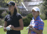 Chelsea Collins , .left, and Sara Wagner, Cherry Creek, right, together watch anothers tee shot...