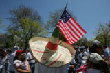 Jose Velasquez (cq) wears a sombrero and a american flag at Broadway and Colfax Monday morning May...