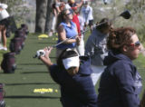 Jazmine Vigil, (cq), 16, Stanley Lake team player center foreground in mid back swing, with white...