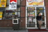 Business owner, Yong Hong (cq) of K Food Markert in Denver, stands outside her store Monday May....