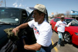 Employees of Bears Car Wash, Pablo Leyva, cq, and Alma Diaz, cq, wear t-shirt with U.S.A. and...