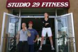 Studio 29 Fitness employees James Bedwell, cq, from left, Michael Knauf, cq, and Danica Ansardy,...