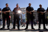 Anti-illegal immigration protester Don Fougner, cq, center, stands behind a line of Denver Police...