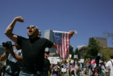 Robert Macias, cq, Thornton, center, chants back at counter protesters during an anti-illegal...