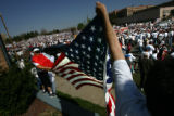 Juaquin Avila, 30, CQ, left, and Norman Marquez, 35, right, hold a Mexican flag and an American...