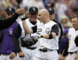 (DENVER shot on 4/4/05)   The Colorado Rockies' Clint Barmes (#12) high fives a teammate as...