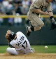 (DENVER shot on 4/4/05)   The Colorado Rockies' Todd Helton (#17, INF) covers his head while...