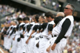 (Denver shot on 4/4/05) Colorado Rockies head coach Clint Hurdle stands alongside a very young...