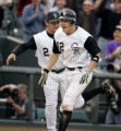 (DENVER shot on 4/4/05)   Colorado Rockies' shortstop Clint Barmes (#12) celebrates with third...