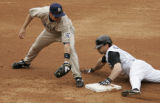 (Denver shot on 4/4/05) Colorado Rockies Aaron Miles(right) slides into second in front of  San...