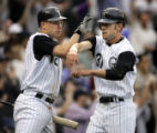 (DENVER shot on 4/4/05)   The Colorado Rockies' Clint Barmes (#12, left) celebrates with teammate...