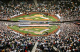 (Denver shot on 4/4/05) The crowd stands for the National Anthem as the Colorado Rockies and the...
