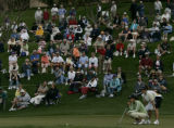 Spectators gather on a hill to watch Michelle Wie, 15, of Honolulu, Hawaii, line up a put on the...