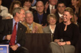 Denver, Colo., photo taken March 21, 2005- President George W. Bush (cq left) talks with Joleen...