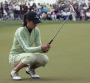 Michelle Wie, 15, of Honolulu, Hawaii reacts to narrowly missing a long putt for birdie on 18 in...