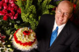 (DENVER, CO. MARCH 30, 2005) Ben Veldkamp (CQ. Ben Veldkamp) CEO of Veldkamp's Flowers, sits among...