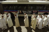 (DENVER, Colo., March 22, 2005) Priests wait along Colfax Ave. to enter the church.  Most Reverend...