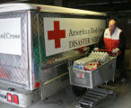 Red Cross volunteer, Paul Madigan (cq), brings supplies to a truck, Thursday afternoon, March 29,...