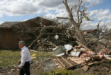 MJM918 Colorado Governor, Bill Ritter, left, walks a portion of the effected area Thursday in...