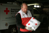 Red Cross volunteer, Paul Madigan (cq), loads blankets into ma box, Thursday afternoon, March 29,...