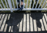 (from left) 2 year-old Brandyn McFadden listens to his grandfather, 63 year-old Rudolph Capuchio...