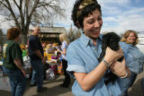 DLM1347  Sarah Julian with Aspen Pet takes the time to cuddle with a puppy after she and her...
