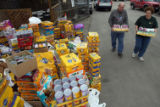 DLM1577  Shelter volunteer Kitty Mirini, right, helps Robert DeBell carry some of the pet food he...