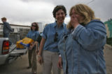 DLM1614  Shelter director Mary Warren, right, is overcome by the generosity of the folks from...