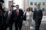 Defense attorney Jeffrey Speiser, left, walks with this client Joe Nacchio, second from left, and...